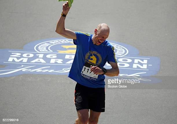 A runner crosses the finish line of the 120th Boston Marathon on Monday April 18 2016 More than 30000 participants registered for the 2016 Boston...