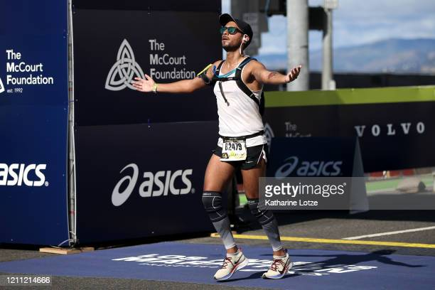 A runner crosses the finish line of the 2020 Los Angeles Marathon on March 08 2020 in Los Angeles California