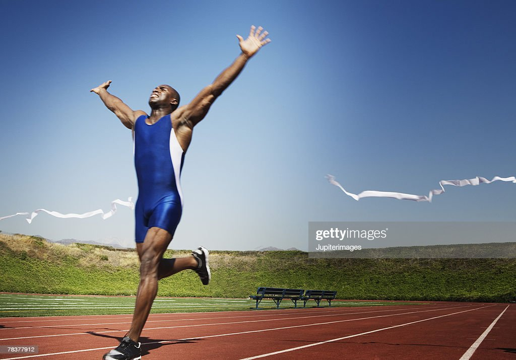 Runner crossing finish line : Stock Photo