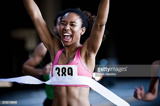 runner crossing the finish line - finish line stock pictures, royalty-free photos & images