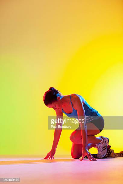 Runner crouched in starting block