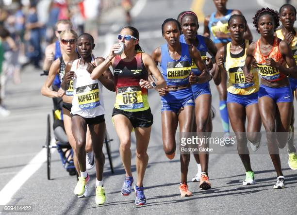 Runner Desiree Linden takes a drink during the running of the 121st Boston Marathon in Natick MA April 17 2017