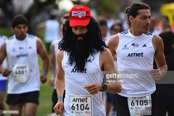 A runner disguised as Forrest Gump during the Buenos Aires Marathon on October 11 2015 in Buenos Aires Argentina