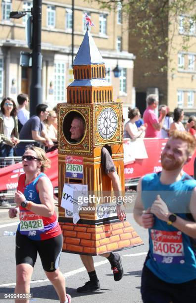 A runner dressed as a the Big Ben tower takes part in the 2018 London Marathon on its way through Greenwich London United Kingdom on April 22 2018