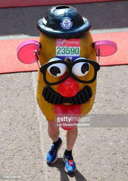 A runner dressed as the toy 'Mr Potato Head' at the finish on The Mall during the London Virgin Marathon on April 22 2018 in London England