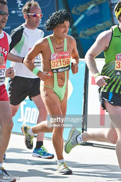 Runner dressed in a green Mankini passes by the Cutty Sark in Greenwich in the 2014 London Marathon on April 13 2014 in London England