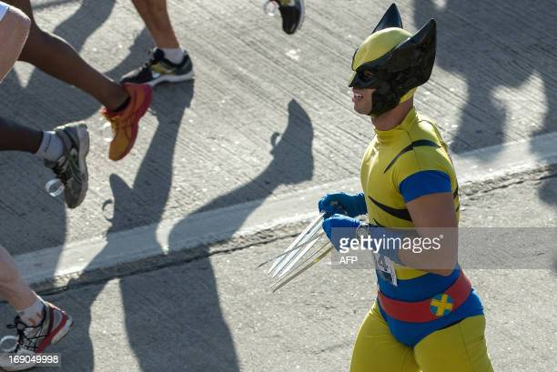 A runner dressedup as Wolverine participates in the annual half marathon Correda da Ponte running accross the RioNiteroi bridge in Niteroi Brazil on...