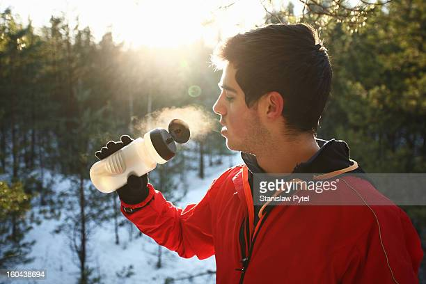Runner drinking water in forest