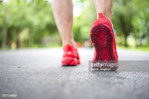 runner feet and red shoes in the park. - 赤の靴 ストックフォトと画像