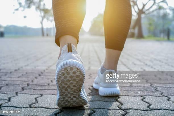 runner feet running on road closeup on shoe. - walking foto e immagini stock