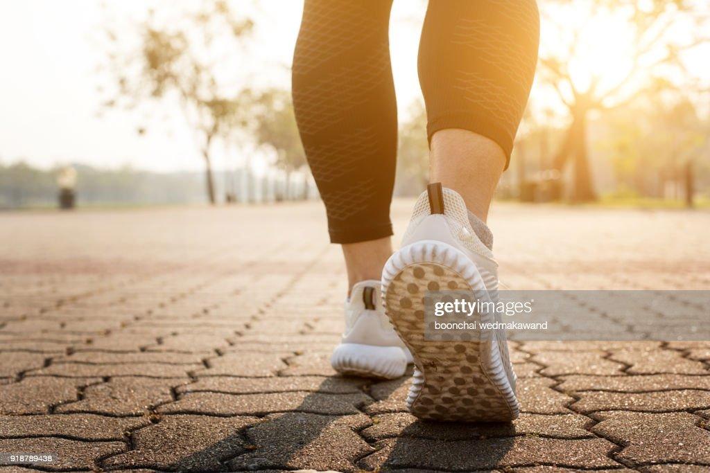 Runner feet running on road closeup on shoe. : Stock Photo