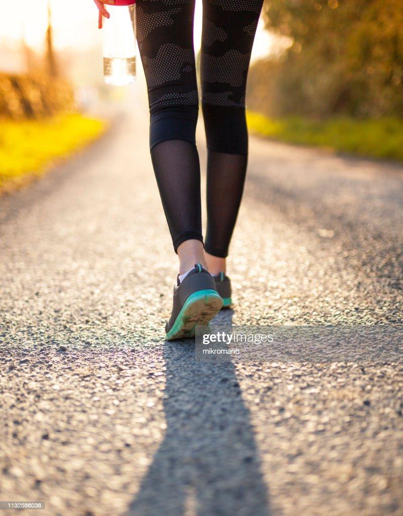 Runner feet running on road : Stock Photo