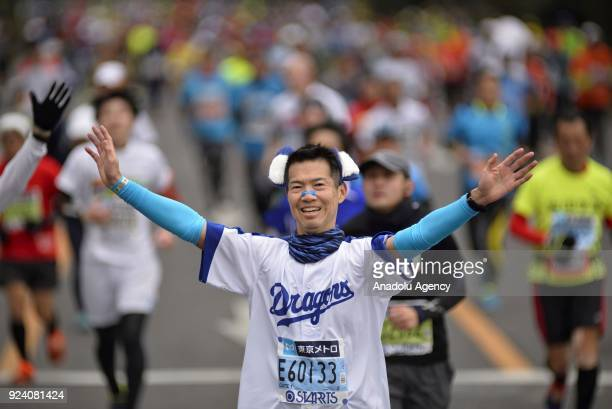 A runner gestures as he competes on the Hibiya street during the 12th Tokyo Marathon in Tokyo Japan on February 25 2018