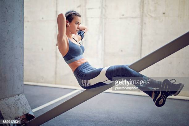 runner girl is making sit ups - composition stock pictures, royalty-free photos & images