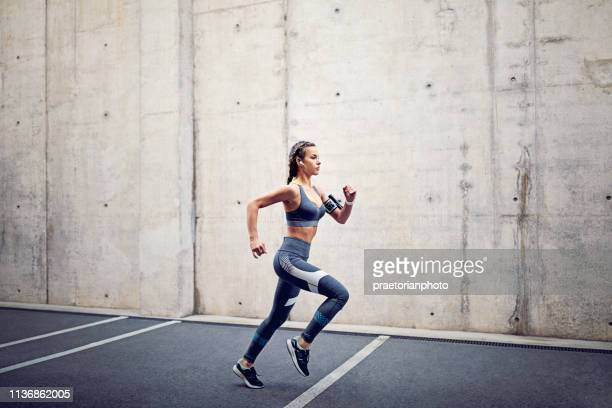 runner girl - track event stock pictures, royalty-free photos & images