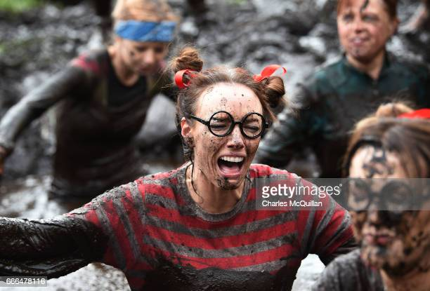 Runner grimaces making her way through a mud sink hole as competitors take part in the annual McVities Mud Madness 8km cross country run on April 9,...