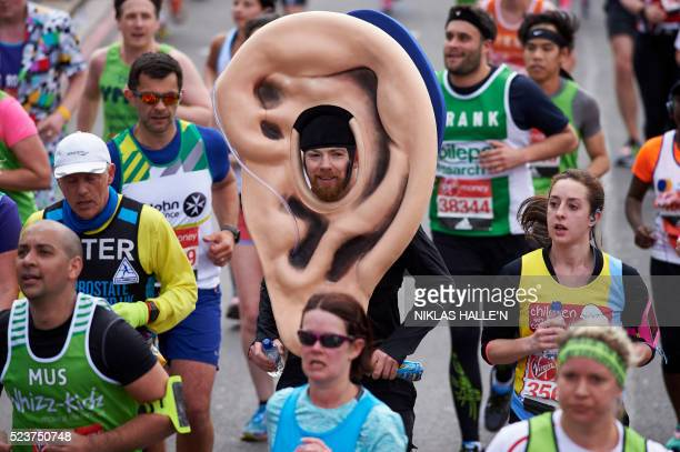 A runner in a fancy dress ear costume takes part in the 2016 London Marathon in central London on April 24 2016 / AFP / NIKLAS HALLE'N