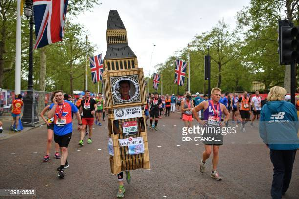 TOPSHOT A runner in fancy dress mixes with other runners recovering after running the 2019 London Marathon in central London on April 28 2019 /...