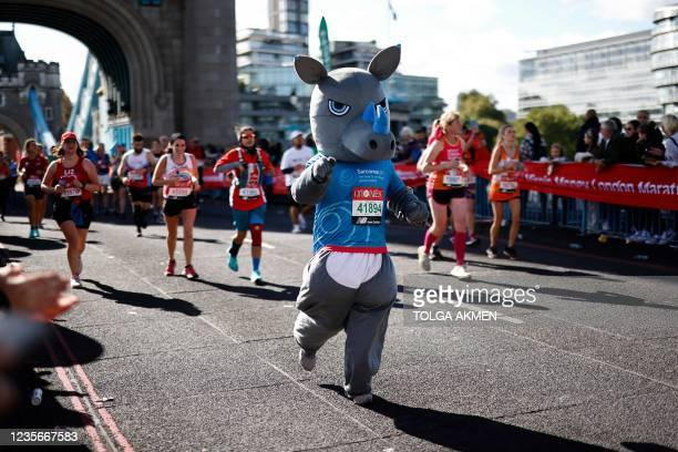 Runner in fancy dress runs over Tower Bridge as they compete in the 2021 London Marathon in central London on October 3, 2021. - - Restricted to...