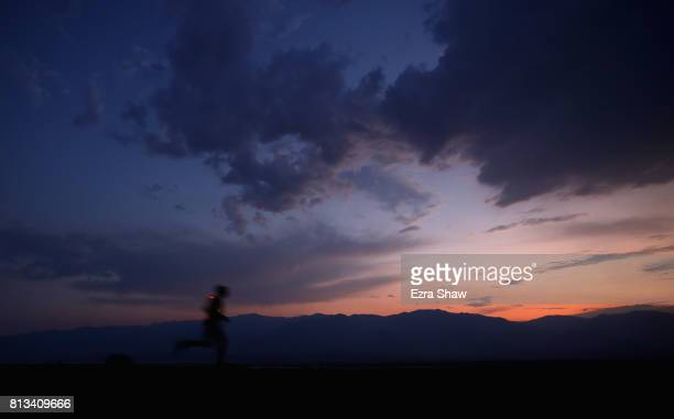 A runner in the 800pm start wave leaves the start line at sunset during the STYR Labs Badwater 135 on July 10 2017 in Death Valley California There...
