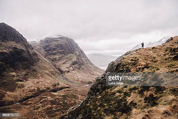 A runner in the distance on mountains of Glencoe