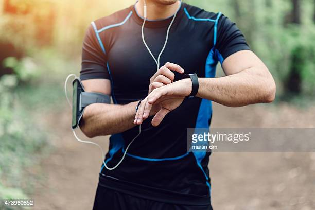 runner in the park preparing for jogging - checking sports stock pictures, royalty-free photos & images
