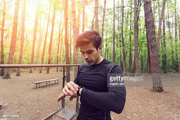 Runner in the park using smart watch