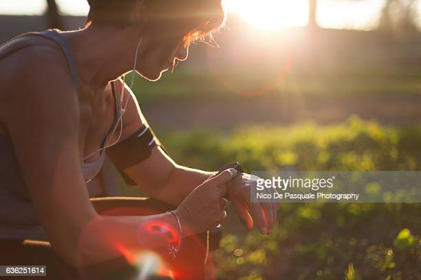 runner in the park using smart watch - wearable computer stock pictures, royalty-free photos & images