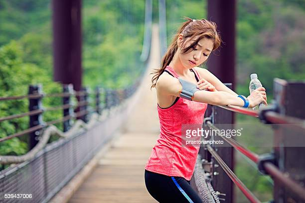 Runner is checking her armband