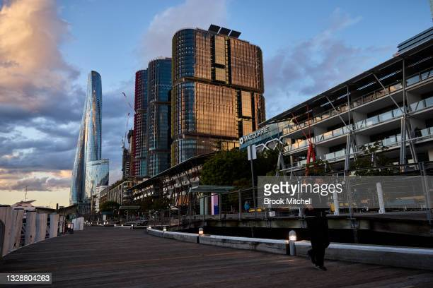 Runner is seen at Darling Harbour on July 15, 2021 in Sydney, Australia. Lockdown restrictions have been extended for at least a further two weeks as...