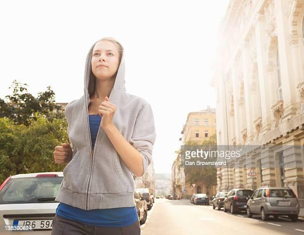 Runner jogging on city street