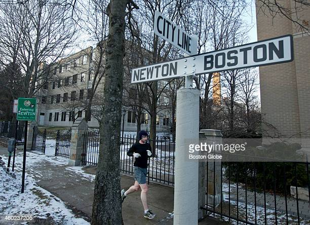A runner jogs past the Merkeret Chemistry Center which sits on the Newton and Boston city line right in front of the Conte Forum the site for...