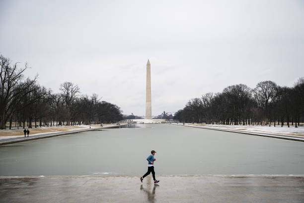 DC: Winter Storm Warning Lifted After Snow And Ice Covered Washington Region