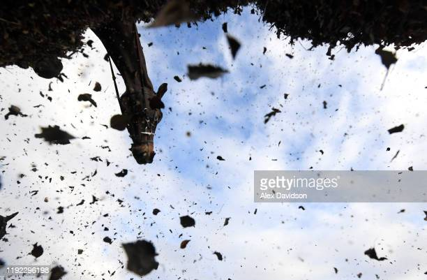 A runner jumps during the JSC Communications Supports Insurance Industry Raceday Handicap Chase at Sandown Park on December 06 2019 in Esher England
