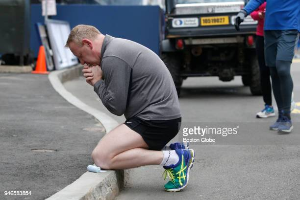 A runner kneels at the site of the bombing and prays on April 15 the five year anniversary of the Boston Marathon bombing