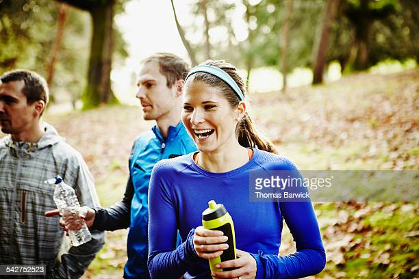 Runner laughing with friends after group run