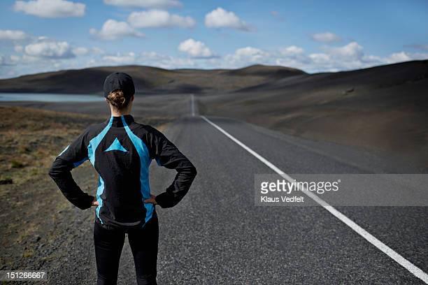 Runner looking down long straight road