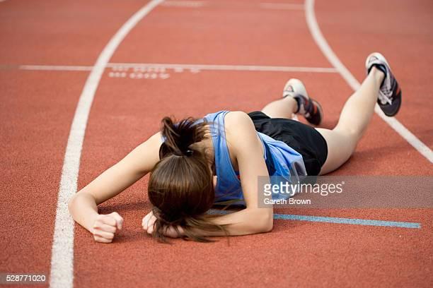 Runner Lying on Track