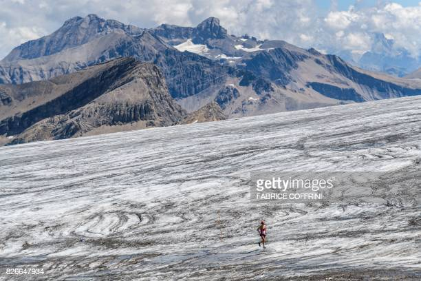 TOPSHOT A runner makes her way on the Tsanfleuron Glacier during the last kilometres of the Glacier 3000 run and marathon above Les Diablerets on...