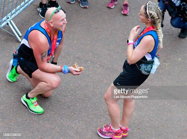 A runner makes marriage proposal at the finish on the Mall during The Virgin London Marathon on April 22 2018 in London England
