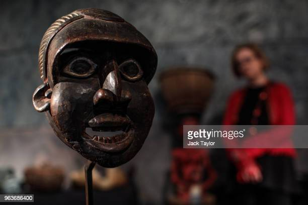 Runner Mask 'Mabu' from the Wum people Cameroon 1930s stands during a press preview at Summers Place Auctions on May 30 2018 in Billingshurst England...