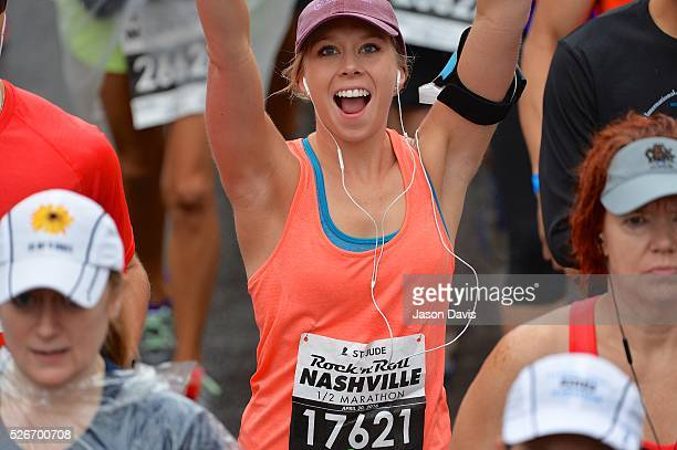 Runner Megan Ostrom crosses the finish line at the St. Jude Rock 'n' Roll Nashville Marathon/Half Marathon and 5k where more than 34,000 participants...