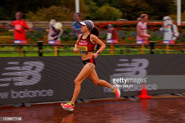 US runner Molly Seidel runs past cutouts during the women's race of the 2020 London Marathon in central London on October 4 2020 This year's London...