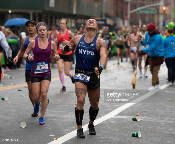 A runner near mile marker 202 in the Bronx grimaces in pain as he competes during the 2017 TCS New York City Marathon in New York on November 5 2017...