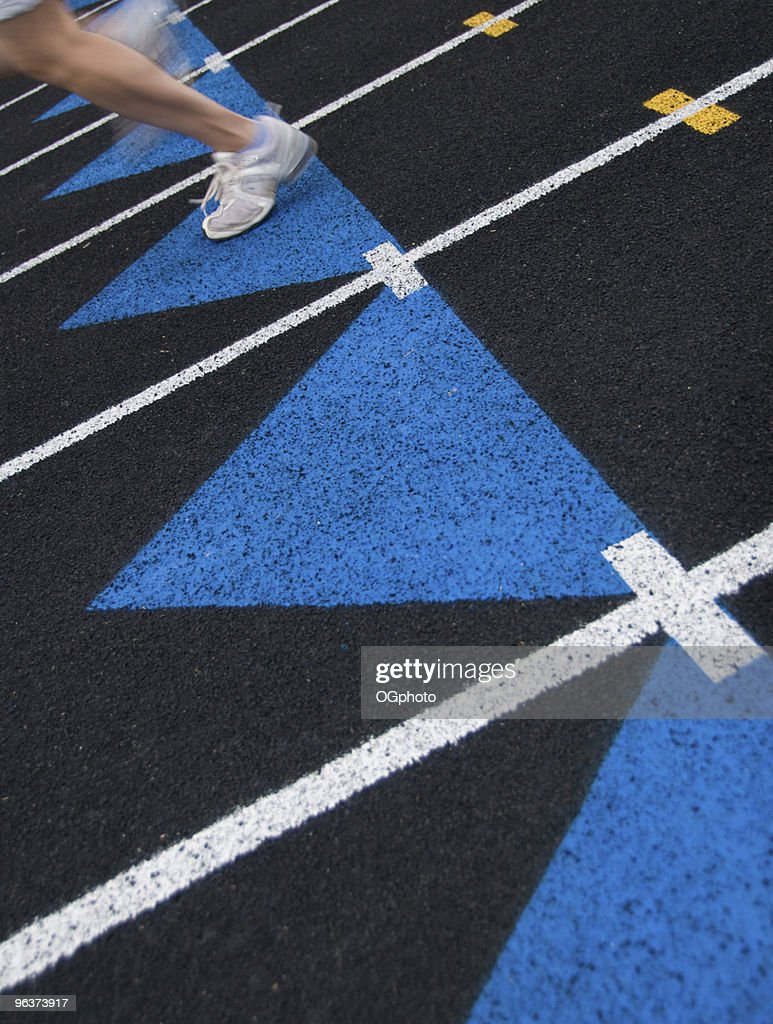 Runner on a black track. : Stock Photo