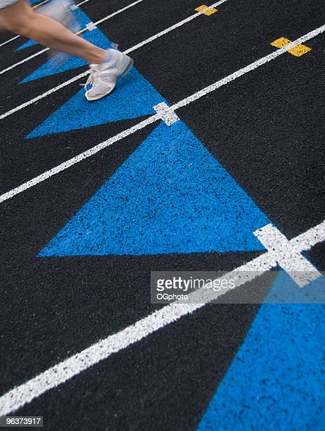 runner on a black track. - ogphoto stock photos and pictures