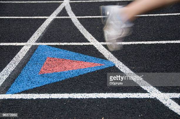 runner on a black track. - ogphoto stock pictures, royalty-free photos & images