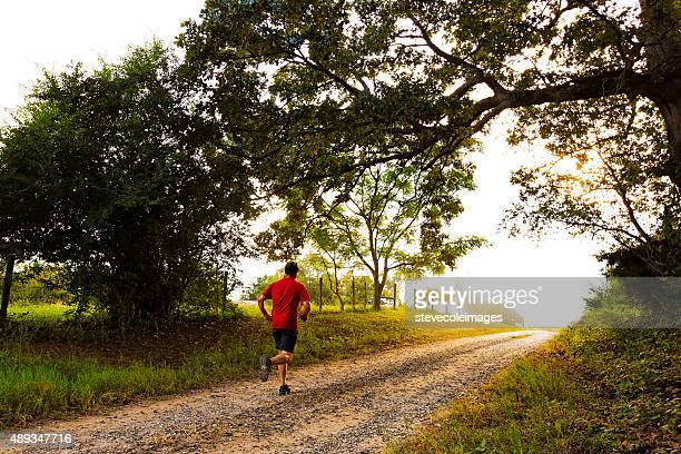runner on country road - georgia country stock pictures, royalty-free photos & images
