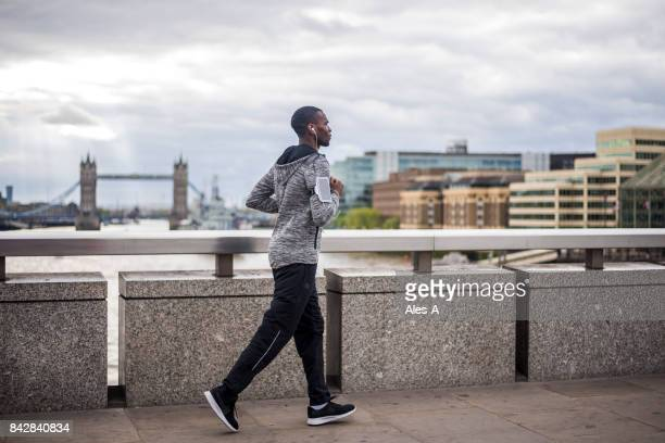 runner on london bridge - tracksuit bottoms stock pictures, royalty-free photos & images