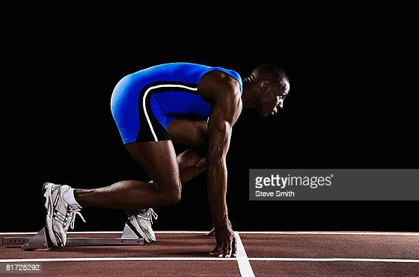 Runner on race track at his mark